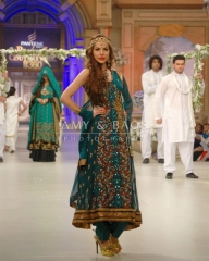 RAMP CAT-WALK MODEL WITH VINTAGE GREEN COLOUR DRESS SUIT